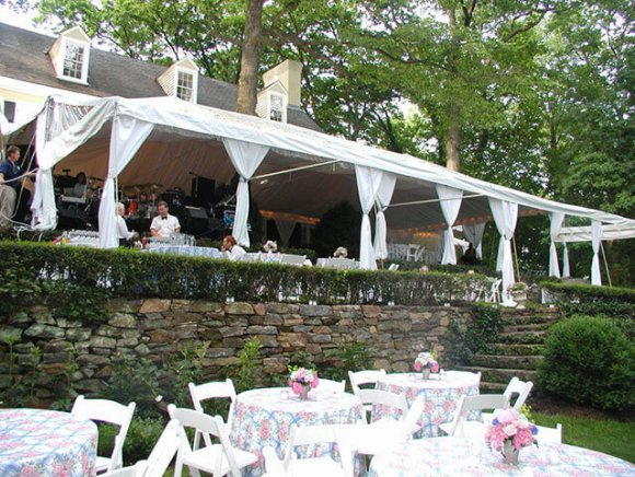 custom-installation-clear-awning-extension-and-tree-throug-tent