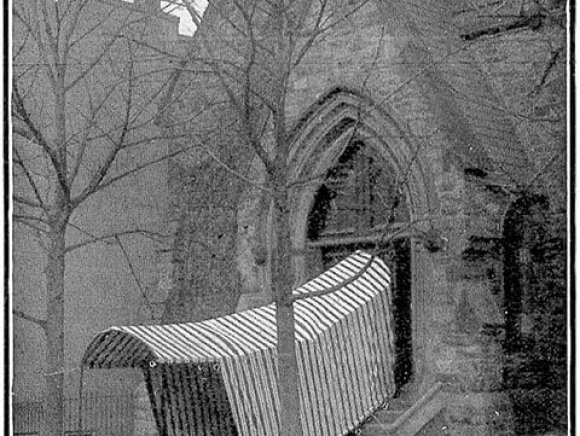 Historical Photo of a canopy tent in front of a church